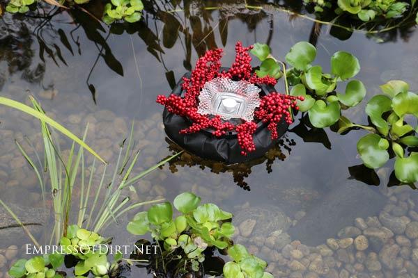Planter floating in garden pond.