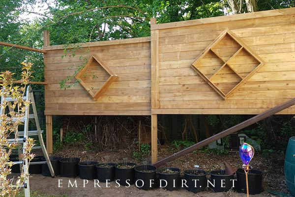 Building a freestanding, outdoor privacy screen with rough-ins for bug hotels.