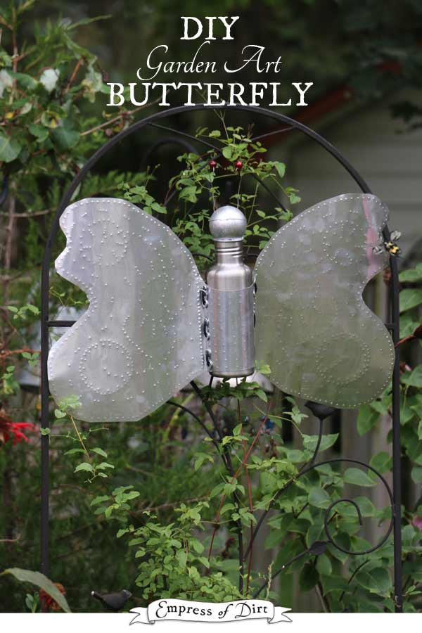 This DIY garden art butterfly is made from an old metal water bottle and a lightbulb.