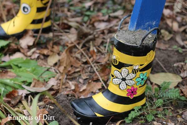 Boots on garden art ladder.