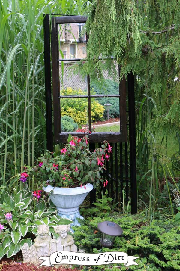 Black garden art door with mirror