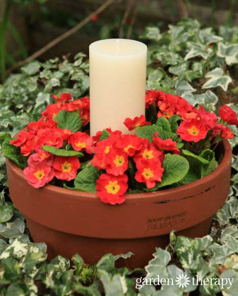Make a clay pot candle planter for your patio. Project by Garden Therapy.