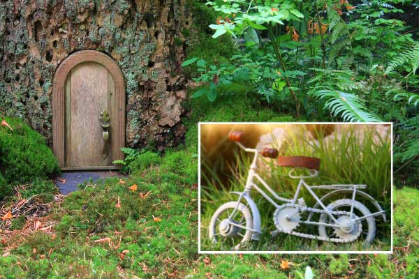 Fairy garden door on a tree and tiny bicycle.