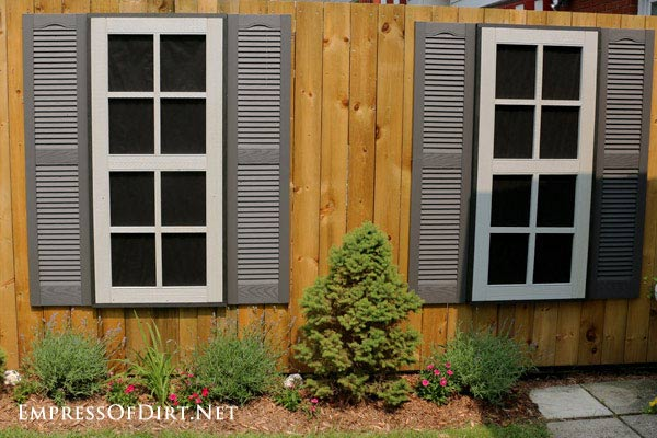 Dress Up a Fence with Faux Windows and Doors