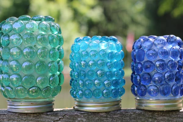 How to make garden art treasure jars with glass gems from the dollar store.