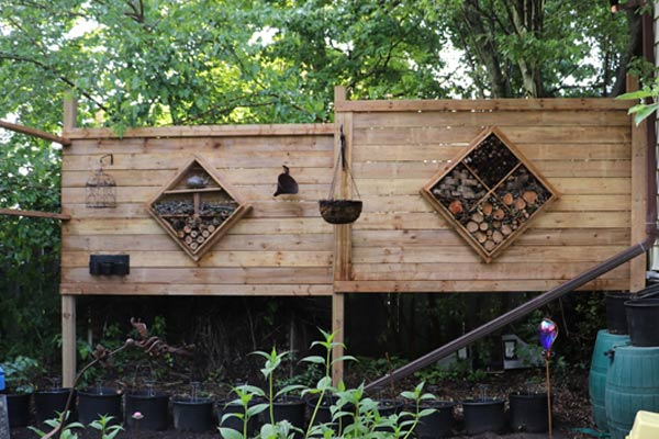 DIY Privacy screen with built-in bug hotels.