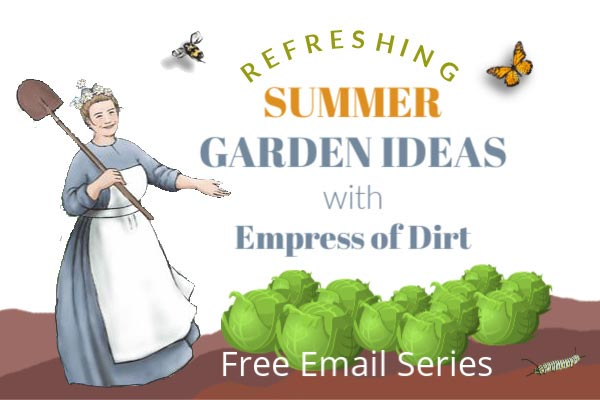 Empress of Dirt in garden with cabbages