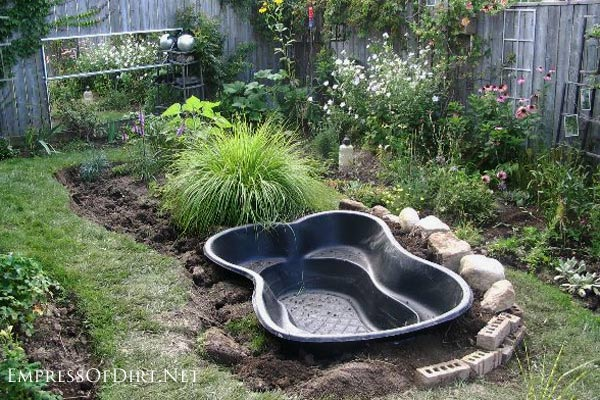 Building a backyard pond read this first empress of dirt for Making a koi pond