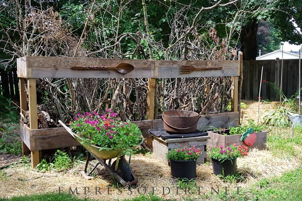 Tree branch crib in garden for birds and pollinators.