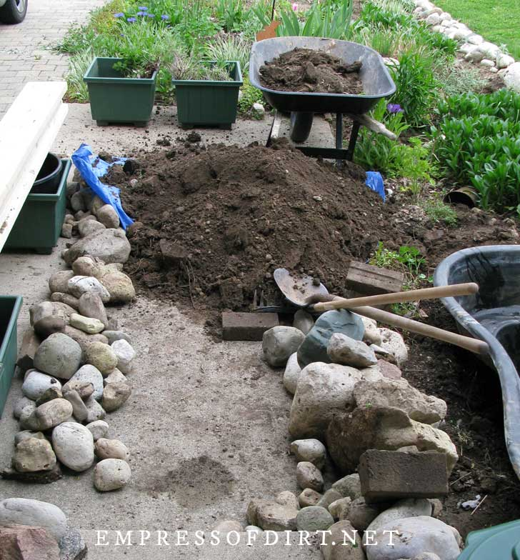 Building pond in a raised garden bed.