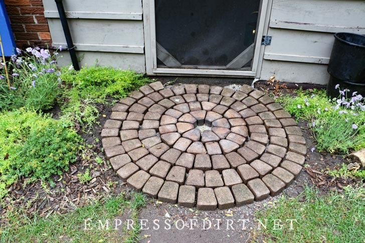 Circle of bricks in garden.
