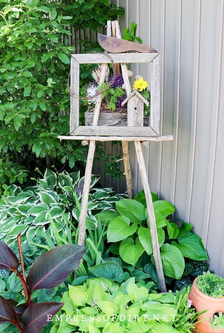 Rustic garden art easel with hostas.