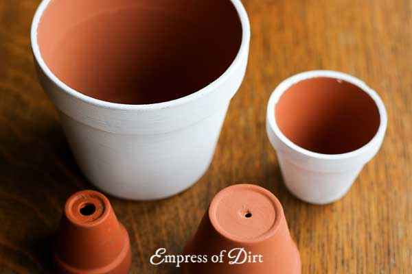 With just a few simple art supplies, you can create charming hand-painted flower pots for your home or garden.