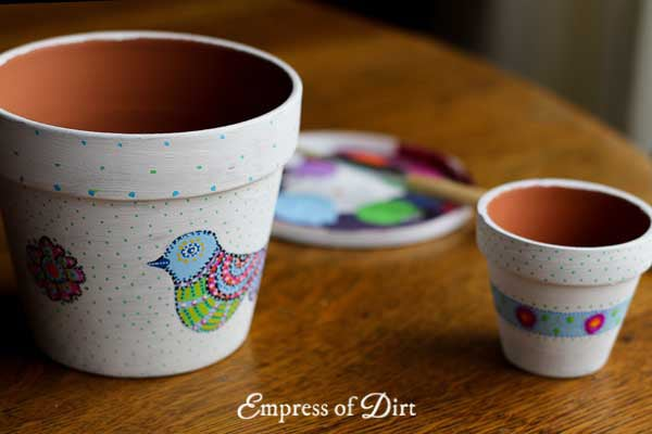 How to hand paint designs on clay garden pots