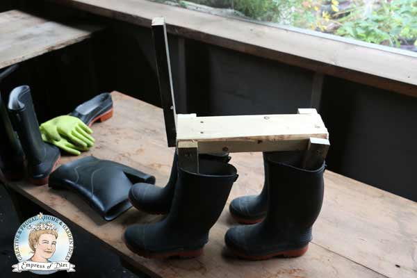 Boot dog frame with four rubber boots for legs.