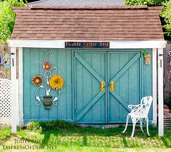 This thrifty backyard shed makeover by Judy Jones shows how you can turn a bland, old shed into something beautiful—topped with garden art, of course—with some frugal upcycles and elbow grease.