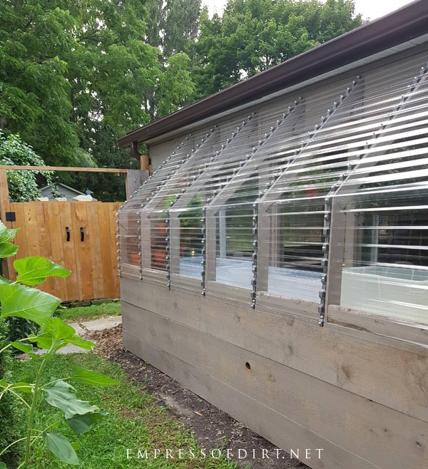 Exterior view of lean-to greenhouse.