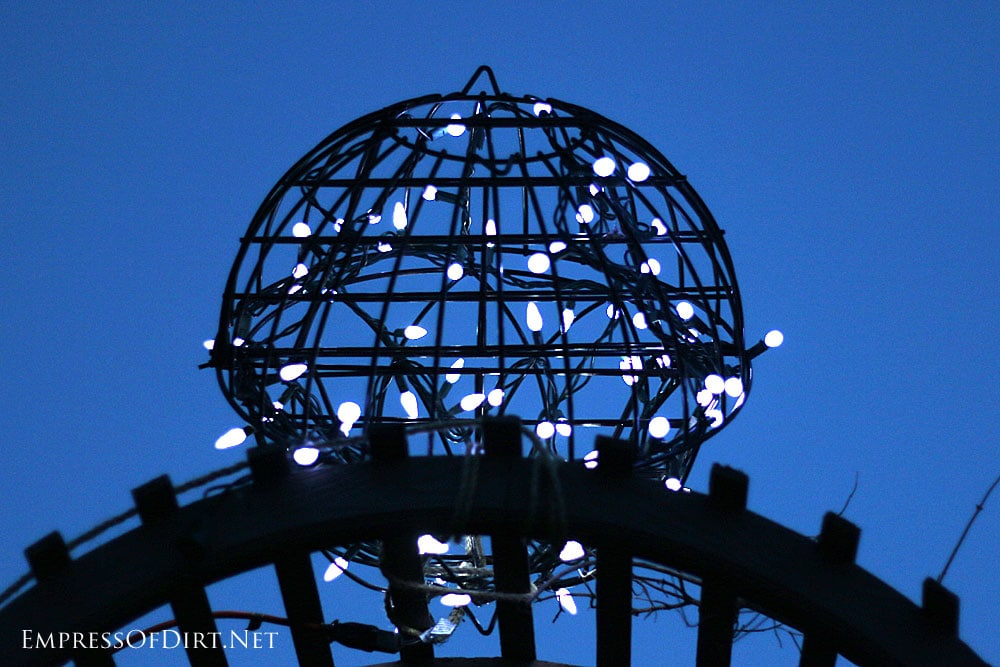 Garden orb with holiday lights in the evening