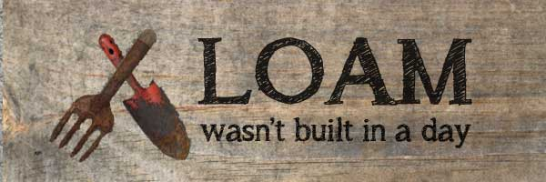 Loam wasn't built in a day garden sign.