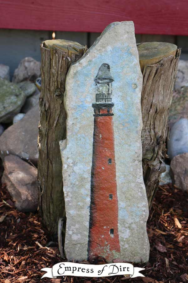 Lighthouse painted on flagstone