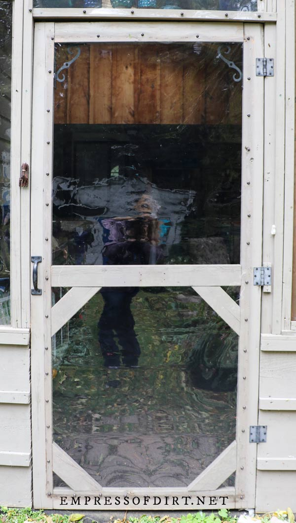 Enclosed patio door with vinyl sheeting.
