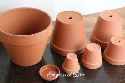 Different sizes of plain clay garden pots.