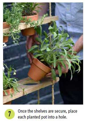 These hanging potted shelves from the book, Big Ideas for Small Spaces, offer a creative way to add vertical, green space to your little garden. Grow a mini herb garden or add trailing, flowering annuals for a burst of colour.
