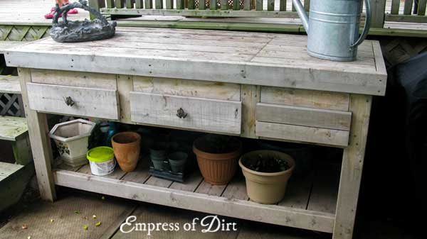 Potting bench with flower pots.