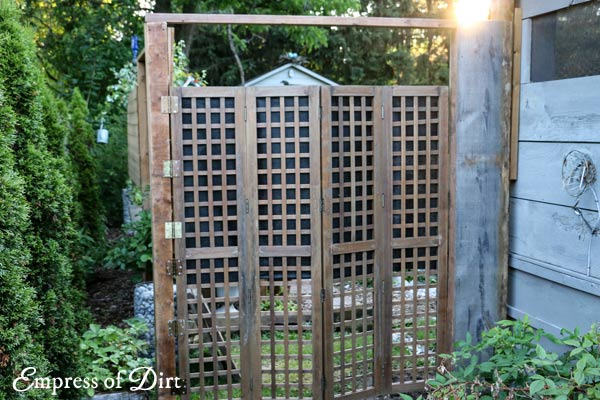 Garden gate made from privacy screen.