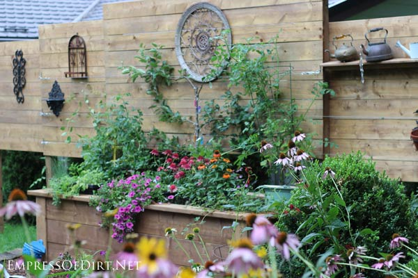 Use a tall raised garden bed to add privacy to your yard.