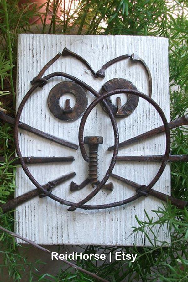 Garden junk cat by ReidHorse on Etsy.