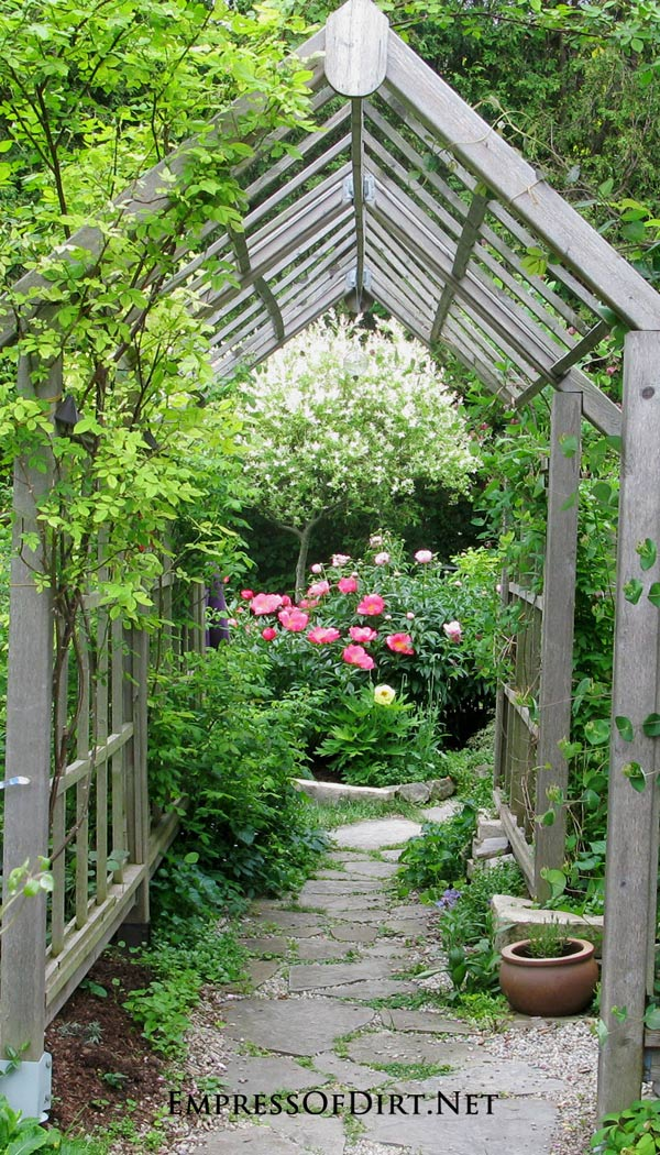 Add a rose arbor over a walkway in the garden.
