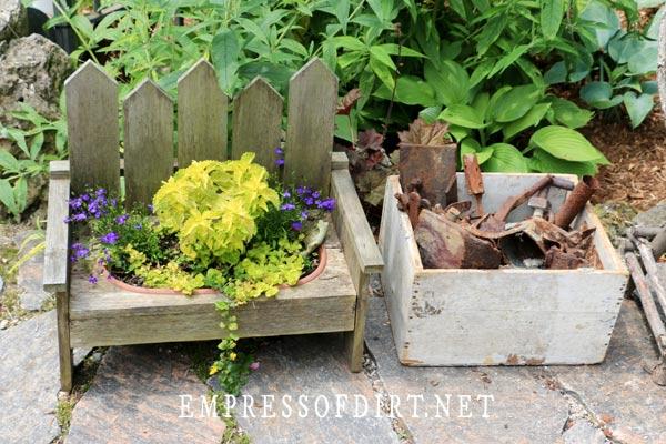Mini garden bench with creeping jenny in planter
