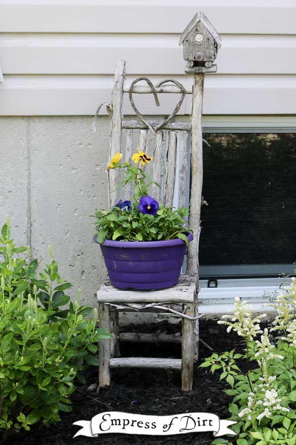 Rustic branch chair with flower pot