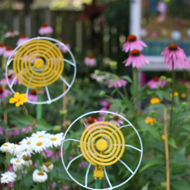 Upcycled garden art flowers made from old stove elements.