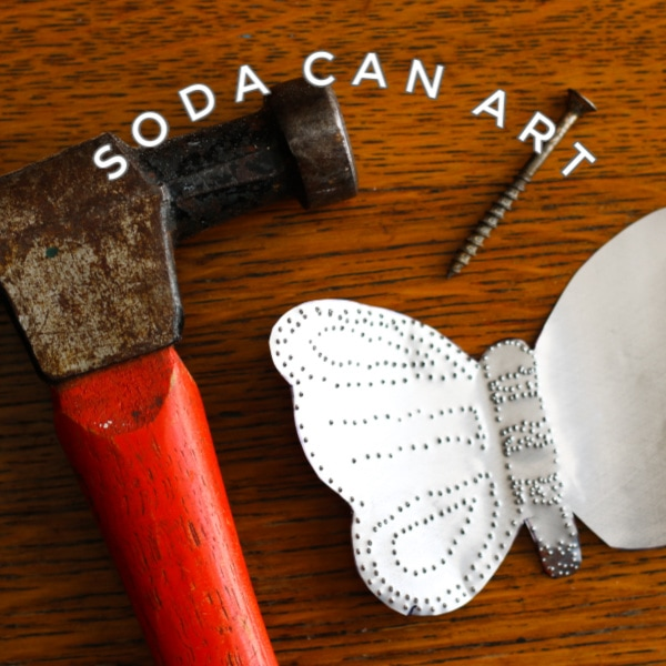 Garden art made from soda cans.