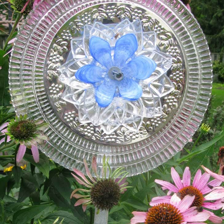 Garden art flower made from old dishes.
