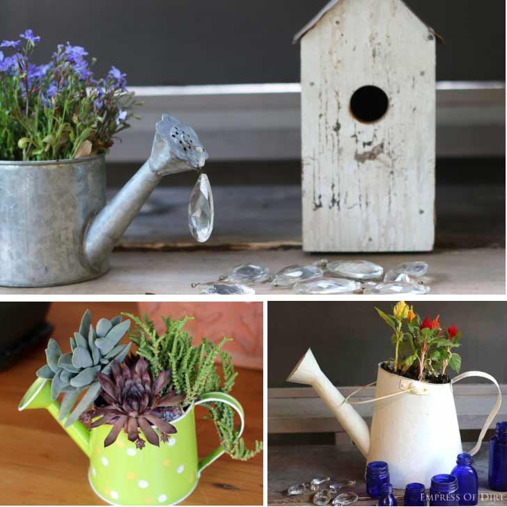 Old watering cans used as garden art and planters.