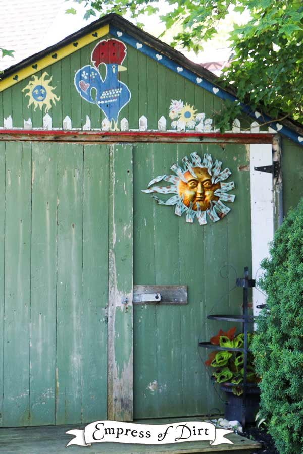 Garden shed with sunface and rooster