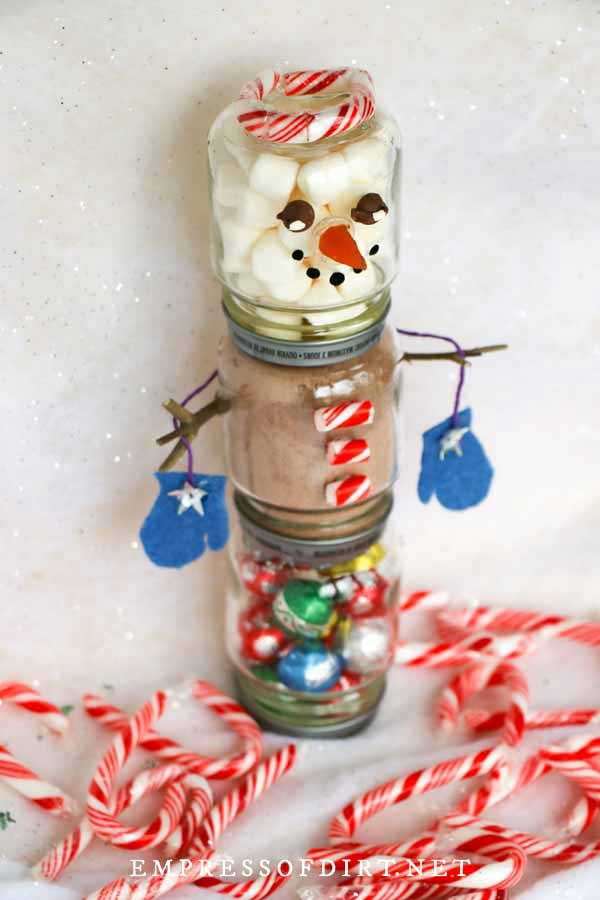 Hot chocolate kit with snowman jar and candy cane details.