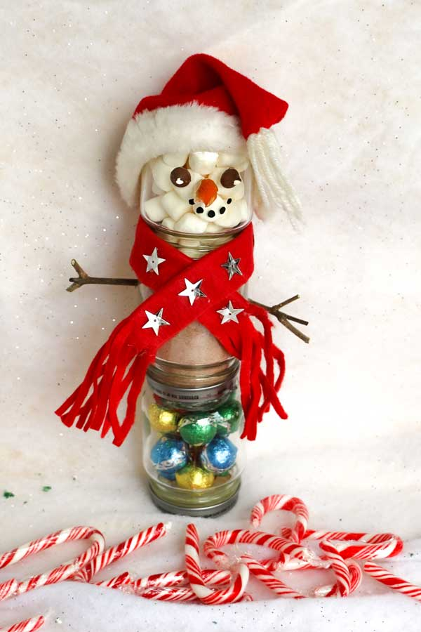 Snowman hot choclate jar with hat and scarf.