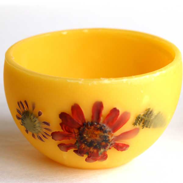 Bowl made from beeswax and decorated with pressed flowers.