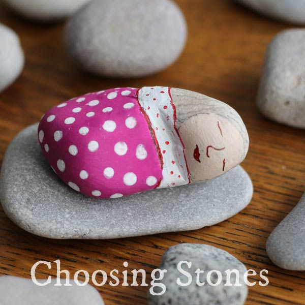 Choosing stones for stone painting.