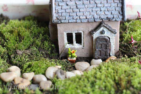 Tiny cottage in miniature garden.