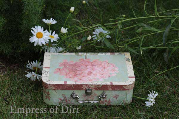 Create a miniature fairy garden in a vintage suitcase. Sweet idea for patio, garden, or inside your home. Kids love it.