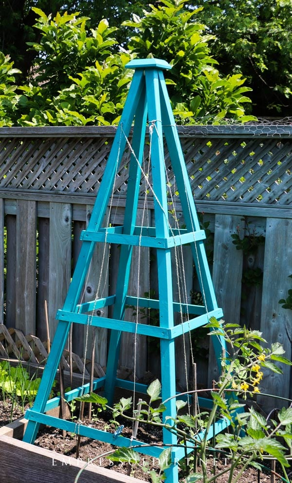 Wood garden obelisk painted turquoise.