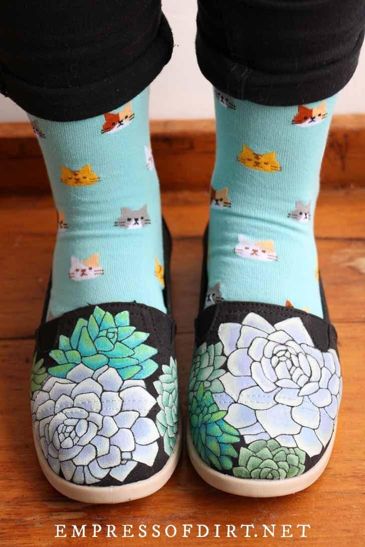 Hand painted canvas shoes with succulent plant designs.