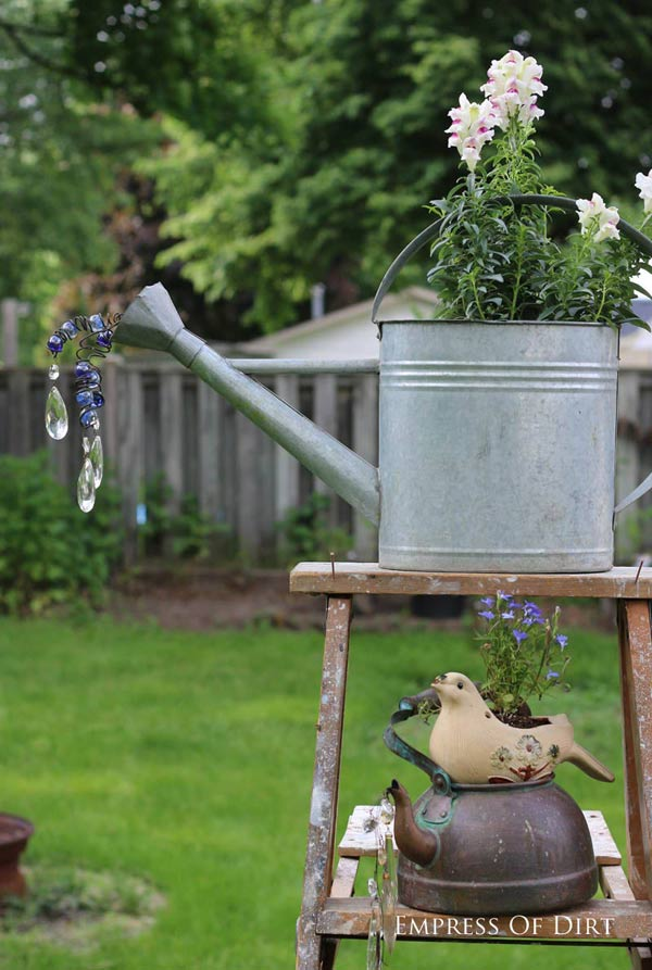 Got an old watering can? Turn it into garden art spilling faux water with wire, marbles, beads, and crystals.
