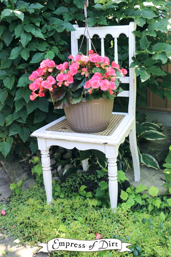 White chair with pink flowers hanging basket