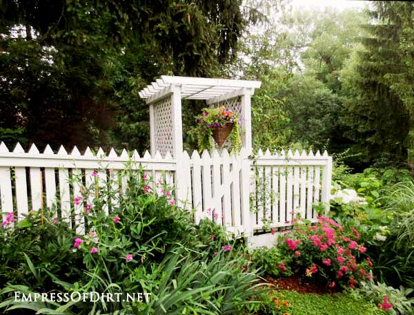 White picket fence and arbor.